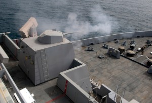 The MK46 Mod 1 weapon system fires a round during a live-fire qualification exercise aboard the amphibious transport dock ship USS New Orleans (LPD-18). US NAvy Photo