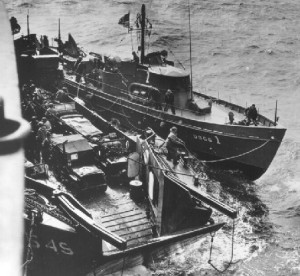 The 83-foot Coast Guard cutter USCG 1 off Omaha Beach on the morning of D-Day, tied up to an LCT and the Samuel Chase