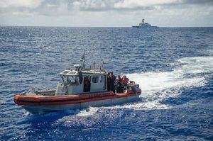 160730-N-KM939-031 PACIFIC OCEAN (July 30, 2016) - Coast Guardsmen, assigned to U.S. Coast Guard cutter Stratton (WMSL 752), make their way to the guided-missile destroyer USS Stockdale (DDG 106) for a rescue and assistance exercise during Rim of the Pacific 2016. Twenty-six nations, 40 ships and submarines, more than 200 aircraft and 25,000 personnel are participating in RIMPAC from June 30 to Aug. 4, in and around the Hawaiian Islands and Southern California. The world's largest international maritime exercise, RIMPAC provides a unique training opportunity that helps participants foster and sustain the cooperative relationships that are critical to ensuring the safety of sea lanes and security on the world's oceans. RIMPAC 2016 is the 25th exercise in the series that began in 1971. (U.S. Navy photo by Mass Communication Specialist 3rd Class David A. Cox)