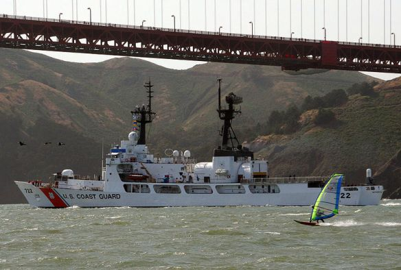 The U.S. Coast Guard cutter USCGC Morgenthau (WHEC-722) heads out to sea from its home port in Alameda, California (USA), passing under the Golden Gate Bridge.