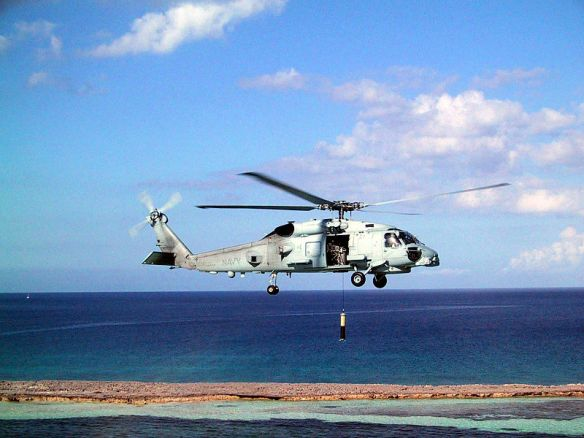 "Navy photo. MH-60R ""Knighthawk"" helicopters conducts an airborne low frequency sonar (ALFS) operation during testing and evaluation"